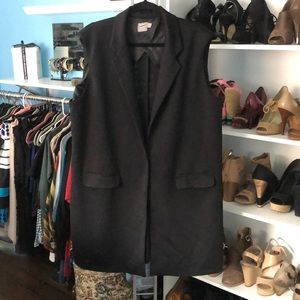 ASOS Plus Size mid length black sleeveless jacket.